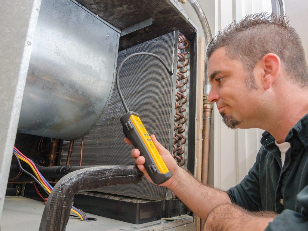 HVAC Technician with Leak Detector