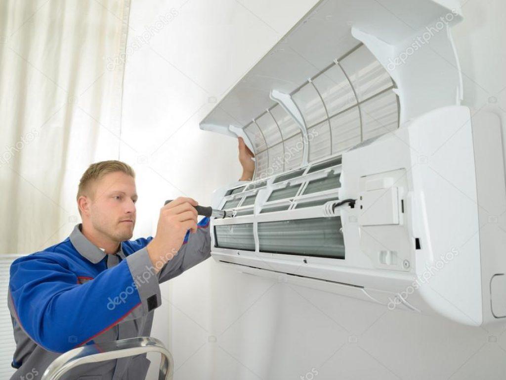 depositphotos_63322175-stock-photo-repairer-repairing-air-conditioner